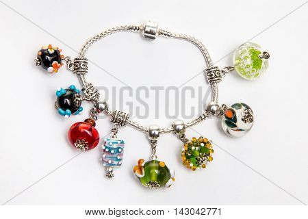 Jewelry with red and blue glass beads on white background