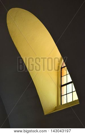 Historical architecture with a window under a curved ceiling taken in a Spanish style hacienda
