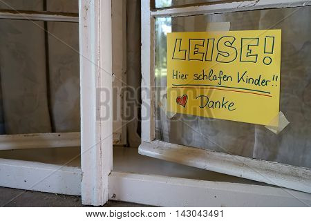 sign at a hostel window with the inscription