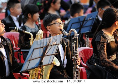 Orel Russia - August 05 2016: Orel city day. Orchrstra of chinese children on stage