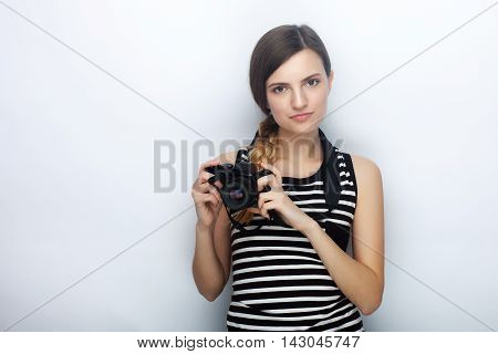 Portrait Of Happy Young Beautiful Woman In Striped Shirt Posing With Black Photo Camera Against Stud