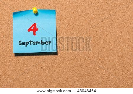 September 4th. Day 4 of month, color sticker calendar on notice board. Autumn time. Empty space for text.
