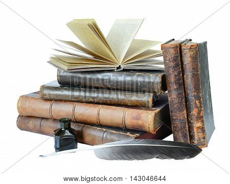 Stack of the old books quill and the inkwell isolated on a white background