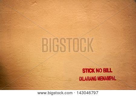 Red stencil on an orange wall in Malacca, Malaysia