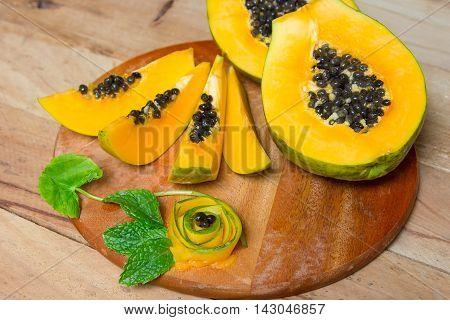 Sliced fresh papaya. Papaya fruit on wooden background.