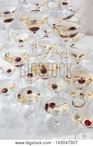 Pyramid of the martini glasses for the wedding event , party with a sweet cherry topping.