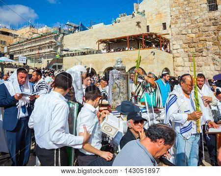 JERUSALEM, ISRAEL - OCTOBER 12, 2014: The Jews brought the Torah scroll for prayer. The area in front of Western Wall of Temple filled with people.  Sukkot