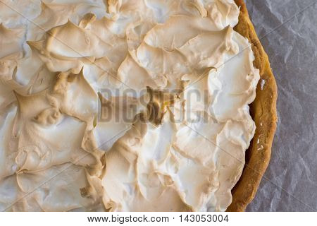 Detailed View On Meringue Cake With Strawberry Jam On Baking Paper