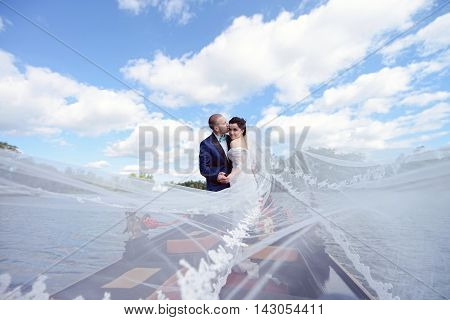 Wedding Couple Is Hugging On A Floating Gondola. Beauty Bride With Groom. Beautiful Model Girl In Wh