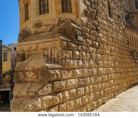 Wall of stones as a background old part of the Jerusalem district of Zion in Israel