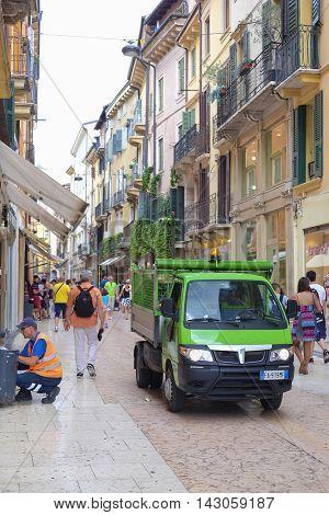 VERONA, ITALY - JULY, 2, 2016: Street cleaning machine on a street of Verona, Italy
