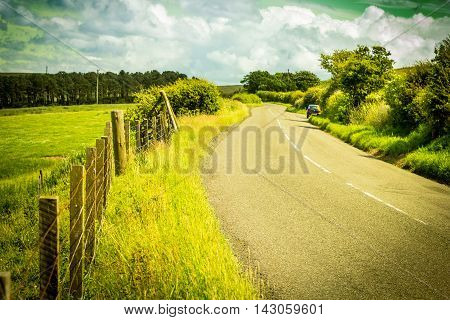 A road in the countryside Scottish summer landscape East Lothians Scotland UK