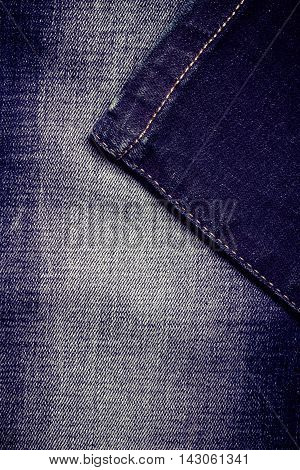closeup detail of blue denim jeans trouses texture background