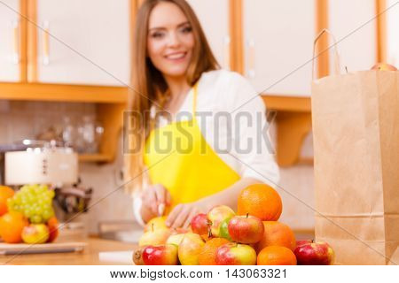 Smiling Lady In Kitchen.
