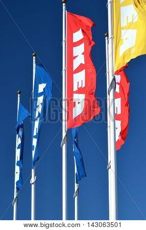 CIRCA AUGUST 2016 - GDANSK: logo of ikea on waving flags against blue sky. IKEA is multinational group of companies designing and selling ready-to-assamble furniture. It was founded in 1943 in Almhult, Sweden.