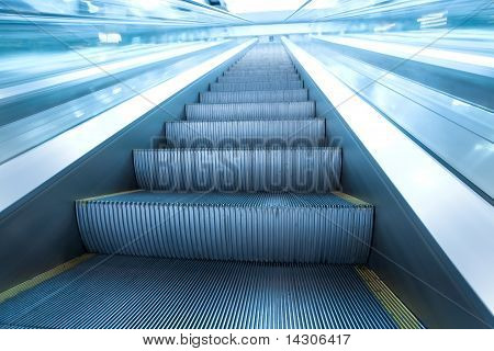 Diminishing Stairway Of Blue Empty Business Escalator