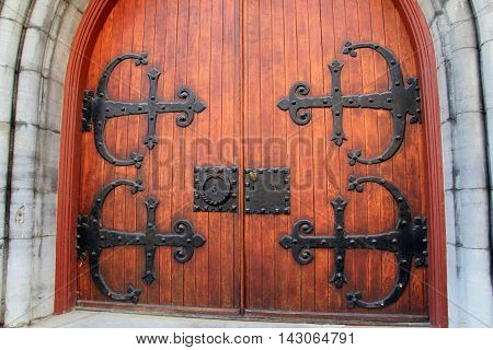 Beautiful wood doors, with impressive black wrought iron hardware  and large handles to open.