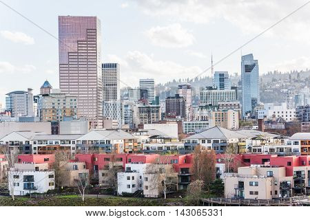 Cityscape of downtown Portland during overcast weather with condominiums