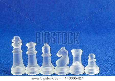 Different chess pieces displayed on a blue background