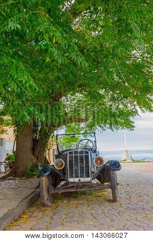 COLONIA DEL SACRAMENTO, URUGUAY - MAY 04, 2016: nice front view of an ancient classic car parked in the street.