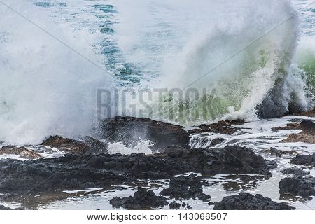 Thors well water splashing against tide pool in Cape Perpetua in Yachats Oregon