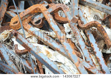 Old rusty railroad spikes and nails displayed outside.