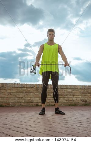 Young Adult Man Model Posing Resistance Band Stretching