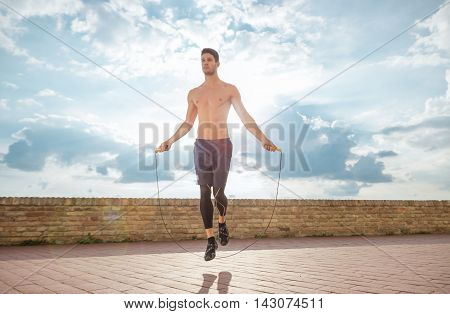 Young Man Jump Jumping Rope Fit Slim Abs Model Sunny Sky