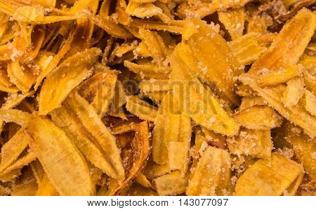 Fried thinly sliced banana chips, a tropical snack.