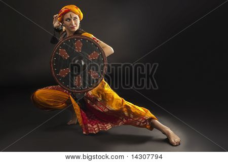 woman posing with shield - arabia theme