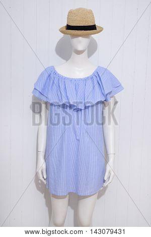 female blue sundress clothing with hat on dummy