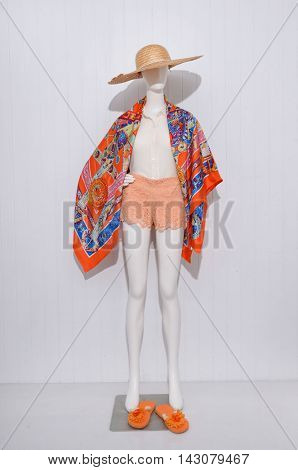 Full length female clothing with scarf ,shoe on mannequin