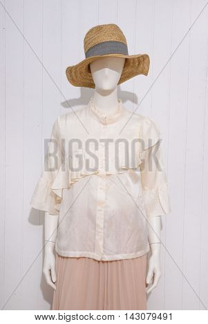 female clothing with hat on mannequin