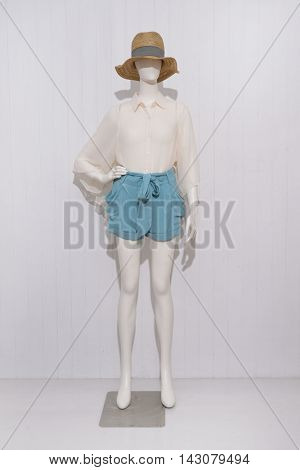 Full length female clothing with hat on mannequin