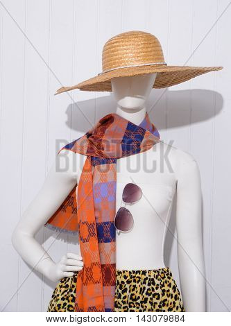 female dress with hat ,sunglasses,scarf on dummy