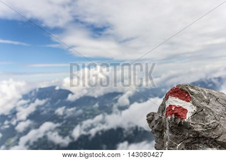 Hiking path markings above the clouds in Austria