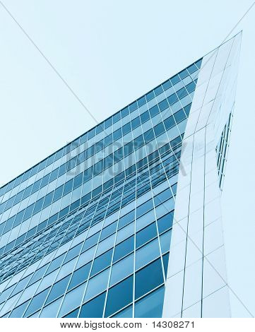 Facade Of Modern Building With Reflection Of Blue Sky