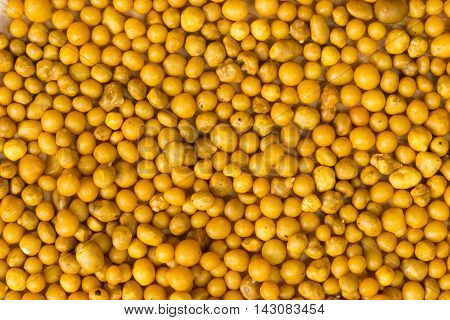 group of yellow fertilizer pellets, top view