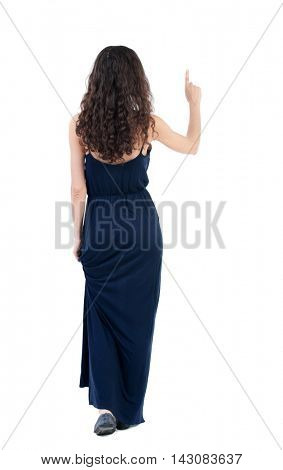 Back view of  woman thumbs up. Rear view people collection. backside view of person. Isolated over white background. Curly dark girl in an evening dress raised her index finger up.