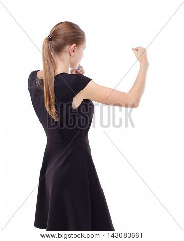 skinny woman funny fights waving his arms and legs. Isolated over white background. Blonde in a short black dress ready to fight.