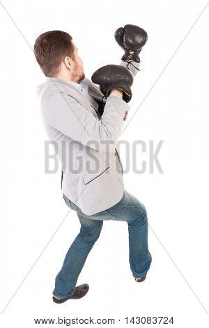 businessman with boxing gloves in fighting stance. Isolated over white background. Rear view people collection.  backside view of person. Top view of a businessman in boxing gloves fighting.