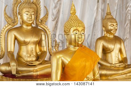 Golden Buddhist Statues And Carving Showing Intricate Details And Textures Created By Buddhist Monks
