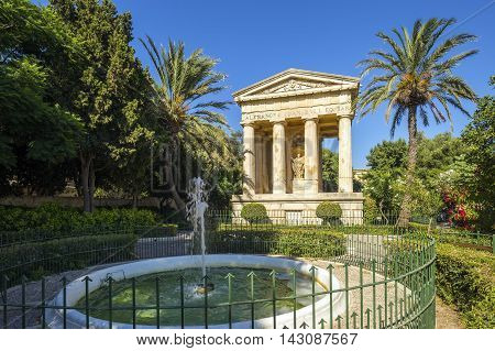 Valletta Malta - The Lower Barrakka Gardens with palm trees and clear blue sky