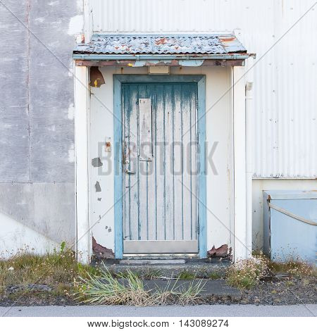 Front view of a boarded-up abandoned building in Iceland - Old USAF base