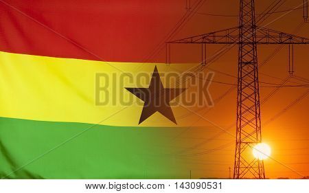 Concept Energy Distribution Flag of Ghana with high voltage power pole during sunset