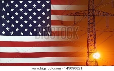 Concept Energy Distribution Flag of USA with high voltage power pole during sunset