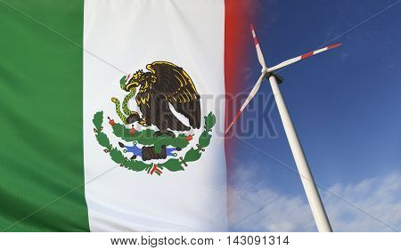 Concept clean energy with flag of Mexico merged with wind turbine in a blue sunny sky
