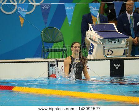RIO DE JANEIRO, BRAZIL - AUGUST 8, 2016: Katinka Hosszu of Hungary celebrates winning gold in the Women's 100m backstroke Final of the Rio 2016 Olympic Games at the Olympic Aquatics Stadium