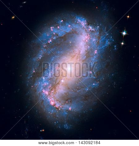 NGC 6217 is a barred spiral galaxy located some 67 million light years away in the constellation Ursa Minor. Retouched image. Elements of this image furnished by NASA.
