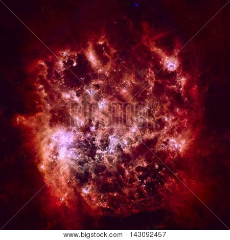 Infrared Portrait of the Large Magellanic Cloud. Cosmic dust clouds ripple across our Milky Way's satellite galaxy the Large Magellanic Cloud. Elements of this image furnished by NASA.